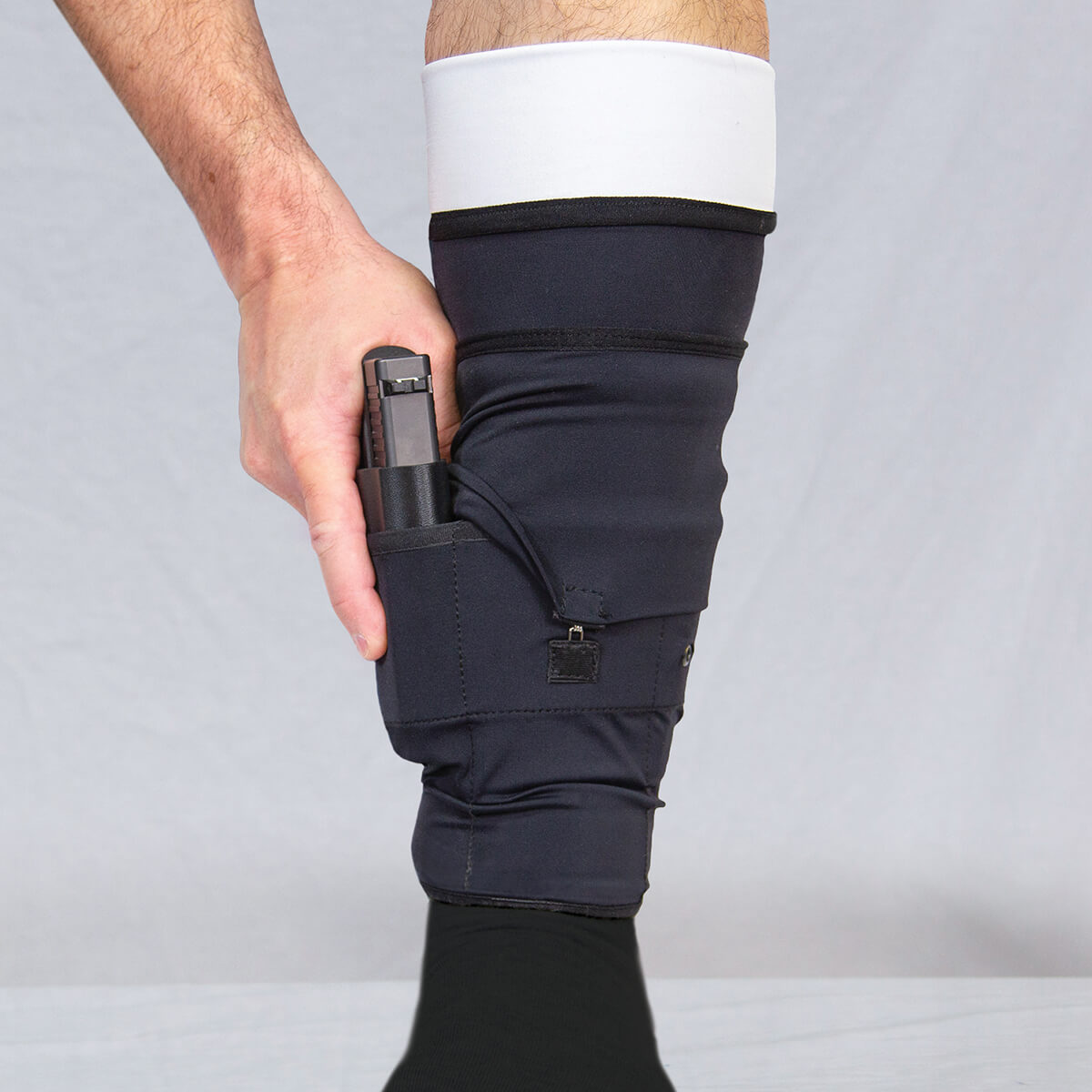 470743_Ankle-Gun-Sox-Pro_Retention-Flap-pulled_Front-view_Flyer